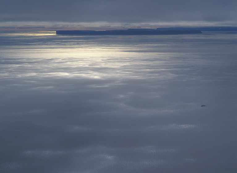 FLYING UNDER A WEATHER CEILING, LIGHT FOG DRIFTS ACROSS THE OCEAN BELOW, 1994