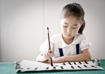 Schoolgirl Practicing Caligraphy