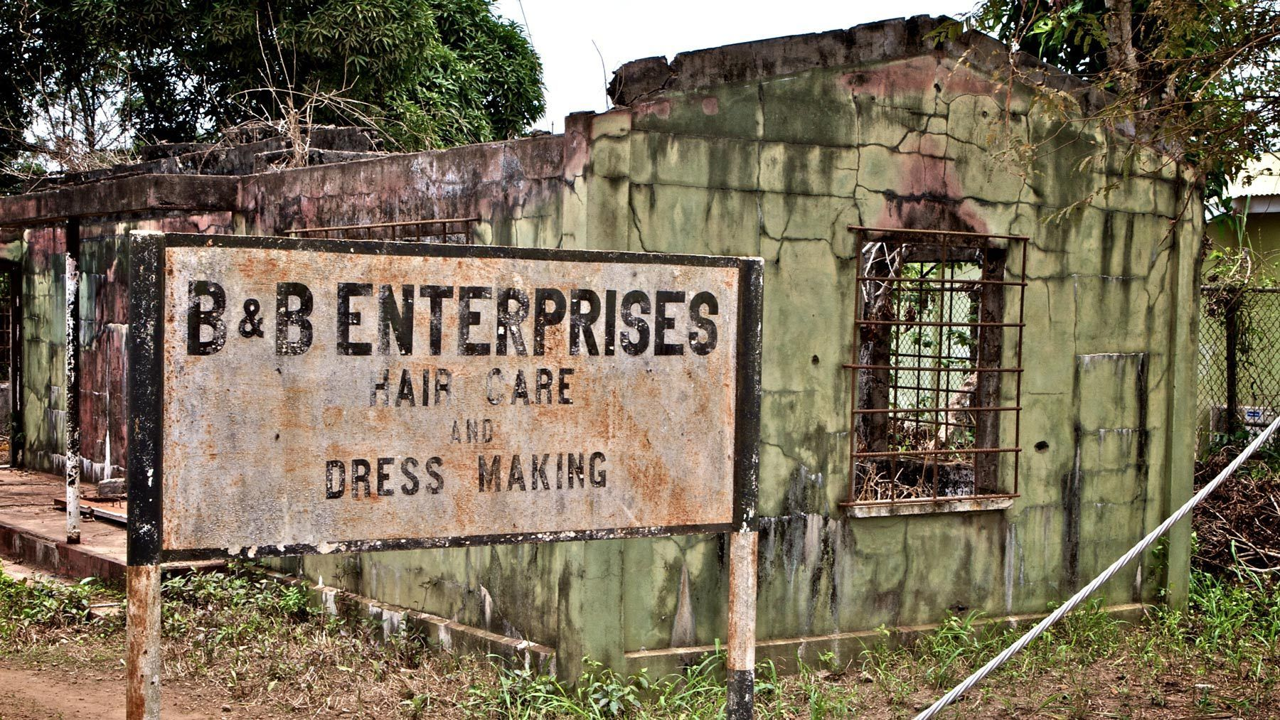 1b_b_enterprises_burned_out_building_sierra_leone.jpg