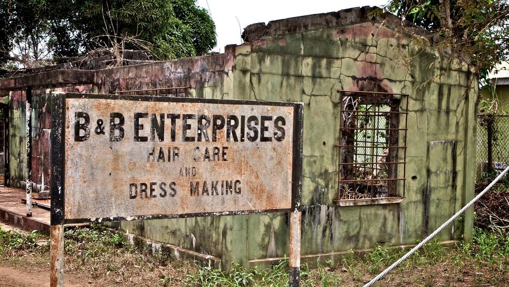1b_b_enterprises_burned_out_building_sierra_leone.jpg
