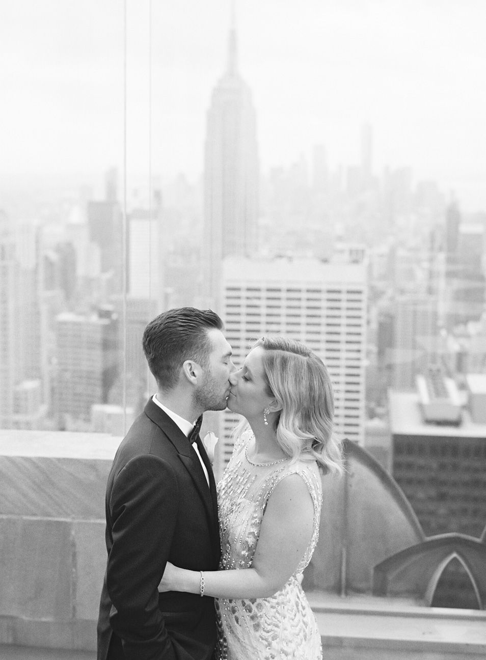 Bride and groom kissing at the Rainbow Room