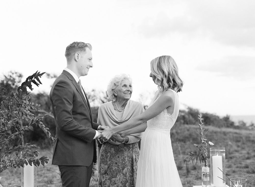 Photojournalistic style bride and groom wedding ceremony moment with grandmother