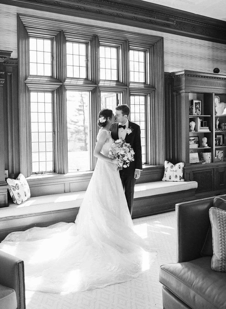 Couple kissing in a mansion