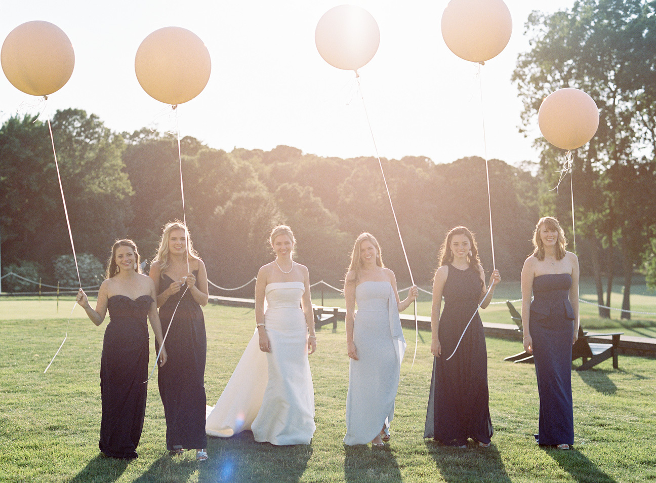 Photojournalistic style of bride and bridesmaids with balloons