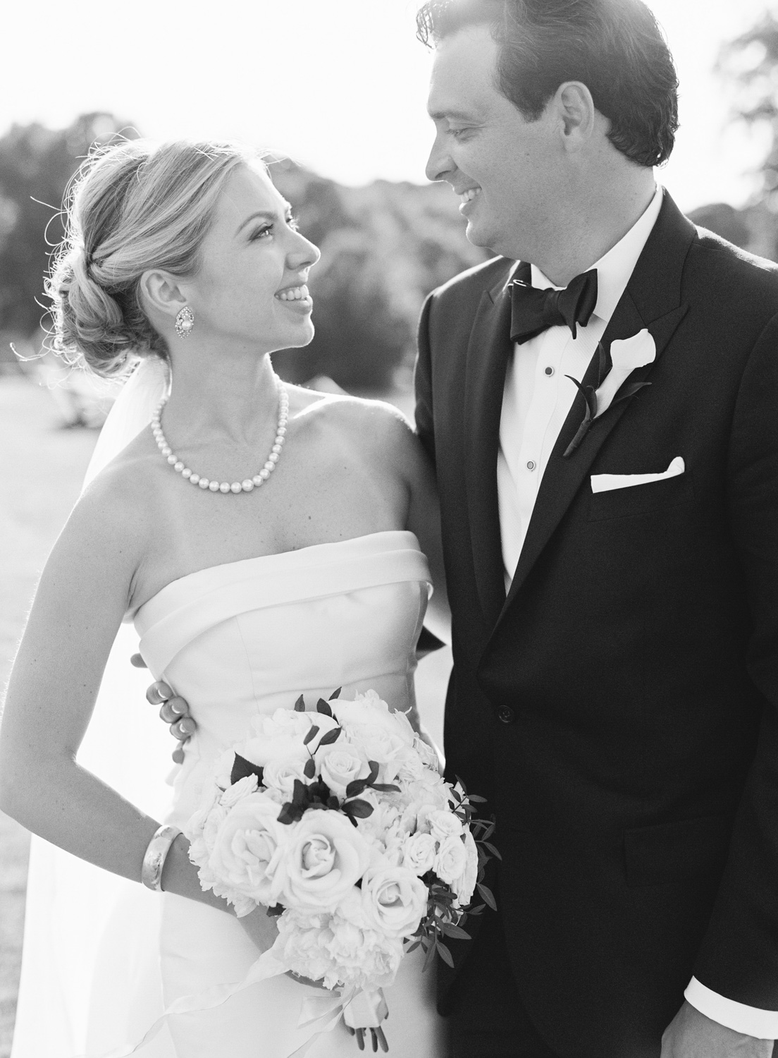 Wedding couple smiling at each other