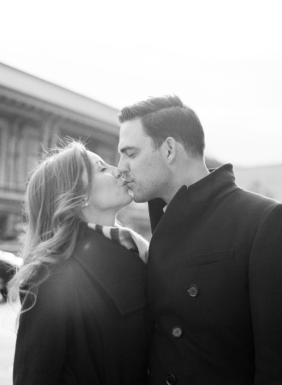 Engaged couple kiss