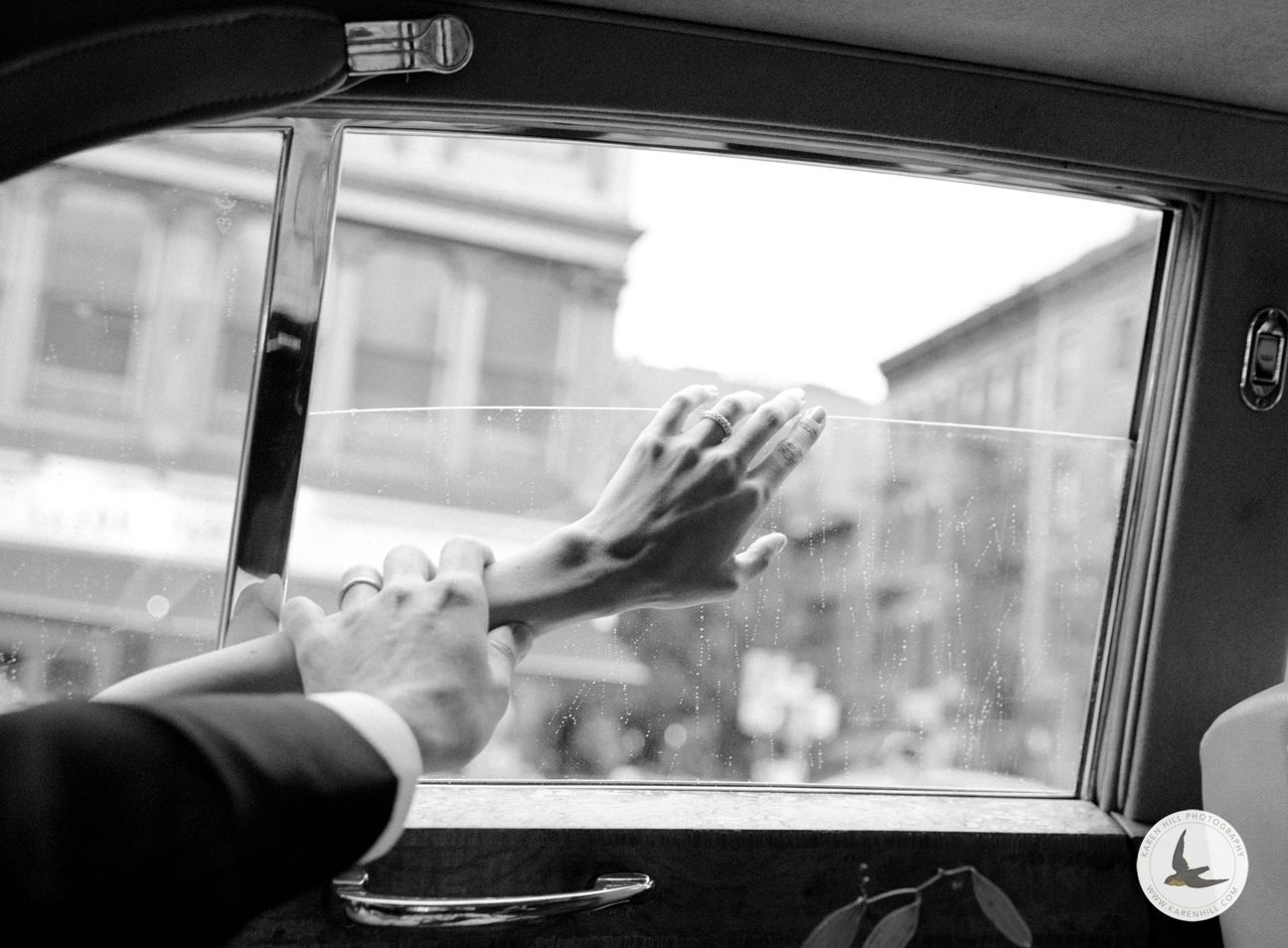 detail photo of bride and grooms wedding rings in wedding car on a rainy day in NYC