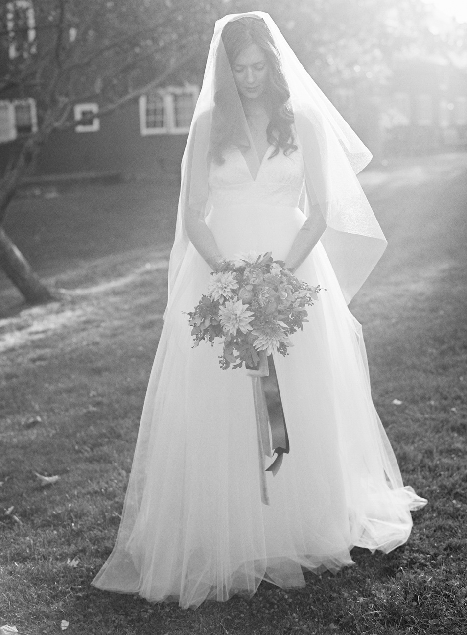 Bride backlit holding a bouquet
