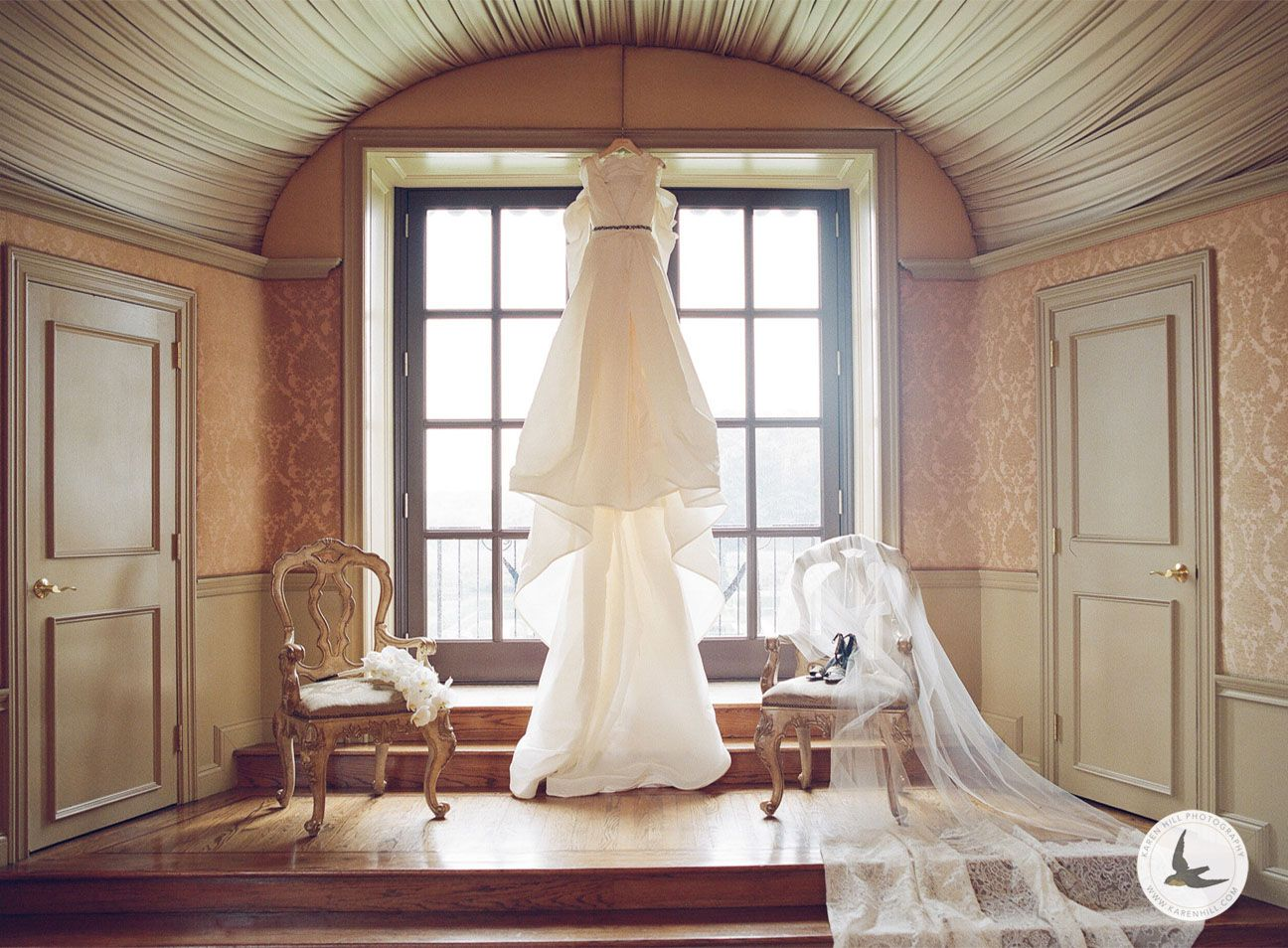 Wedding gown hung in a window by Vera Wang.jpg