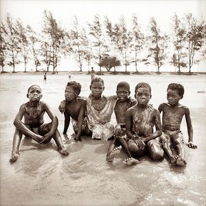 Orphans playing in the Sea / Mozambique