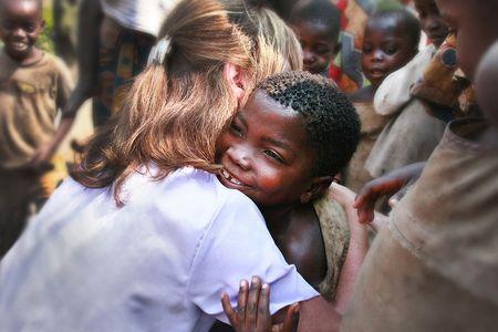 A hug to the Twa children / World Challenge humanitarian aid efforts Burundi, Africa