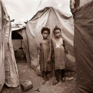Two girls in a Tent city / Haiti