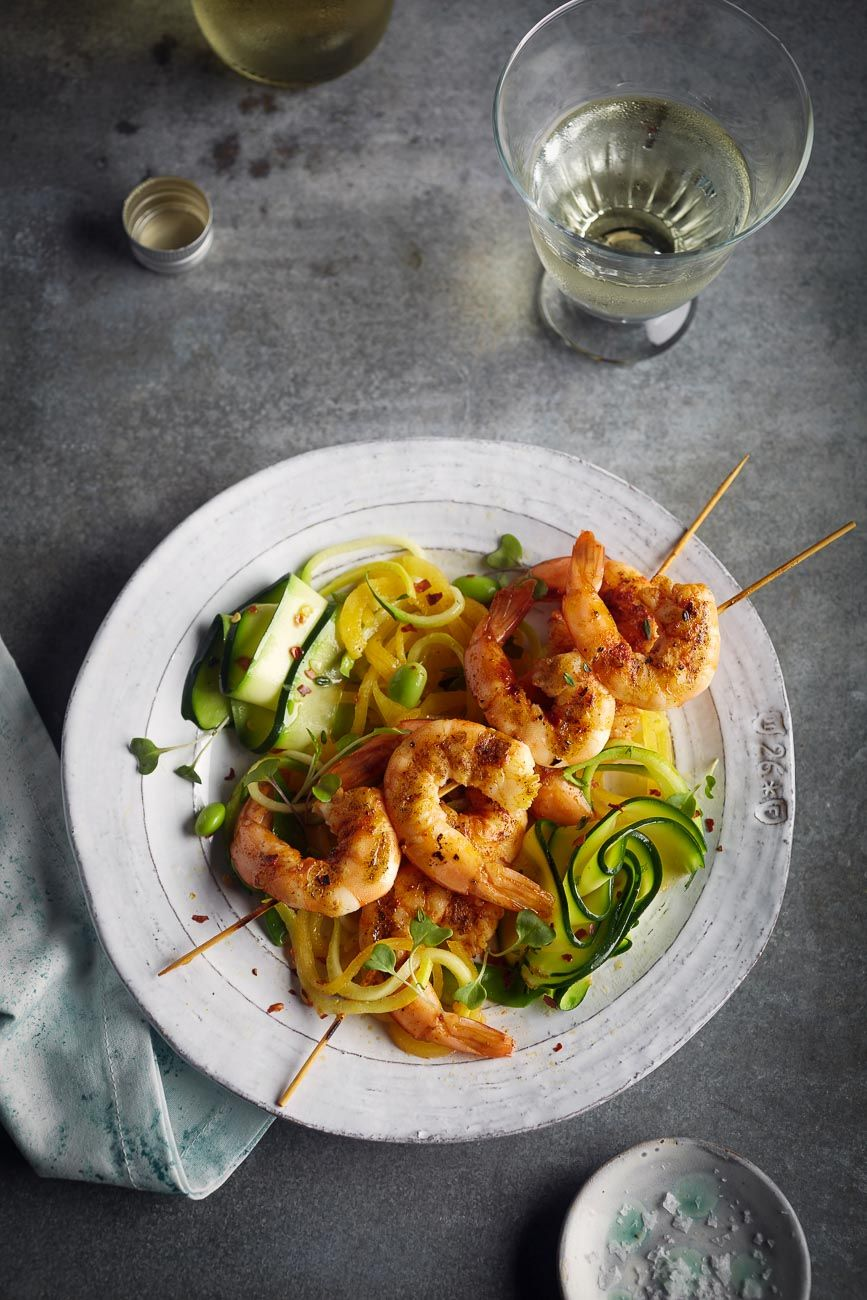 Prawn skewers and zucchini ribbon pasta