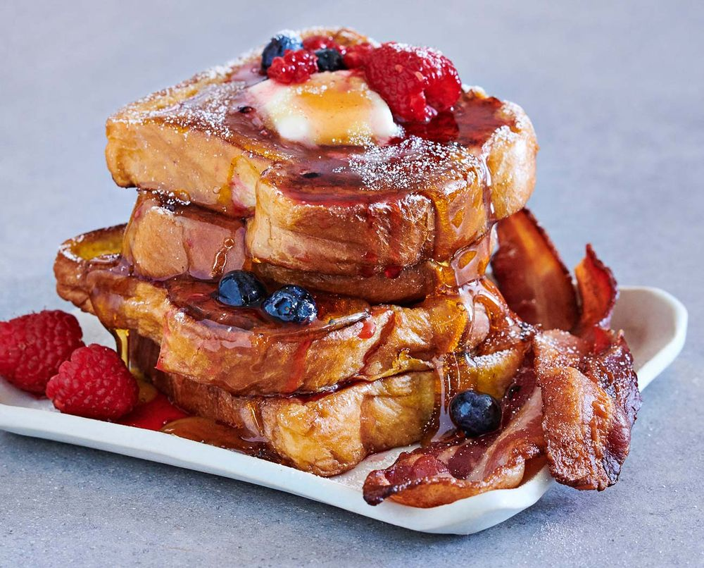 Stack of cinnamon French toast with bacon