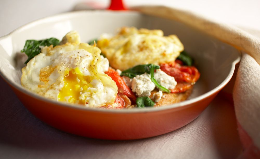 Fried eggs vegetables and cheese