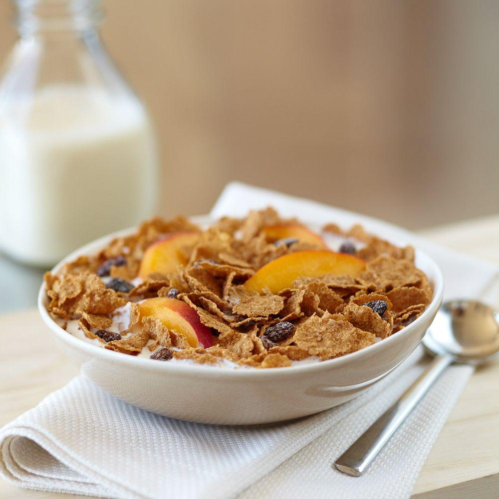 Raisin bran cereal and peaches