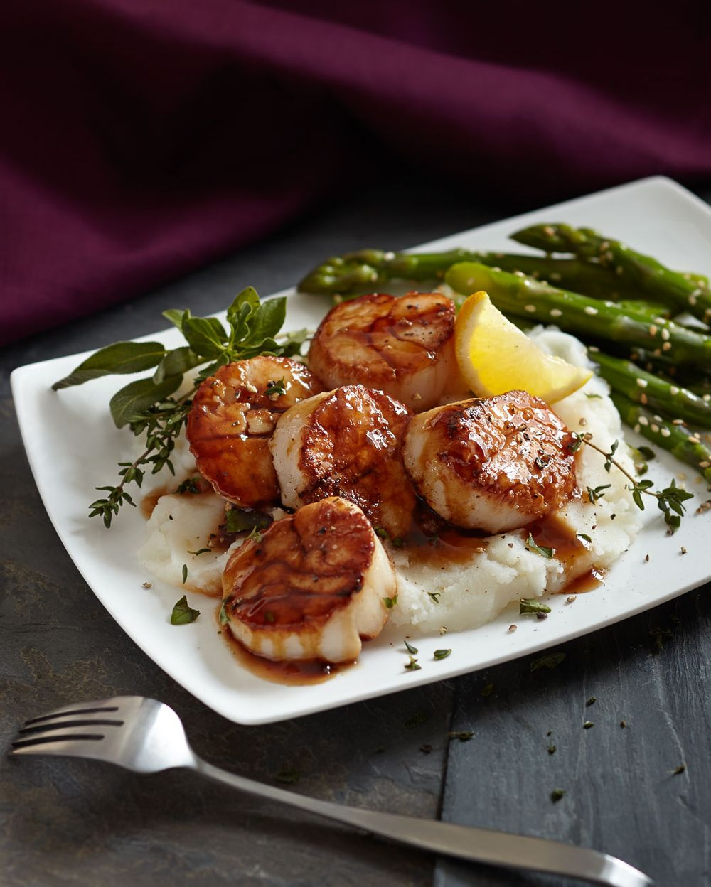 Scallops mashed potatoes and asparagus