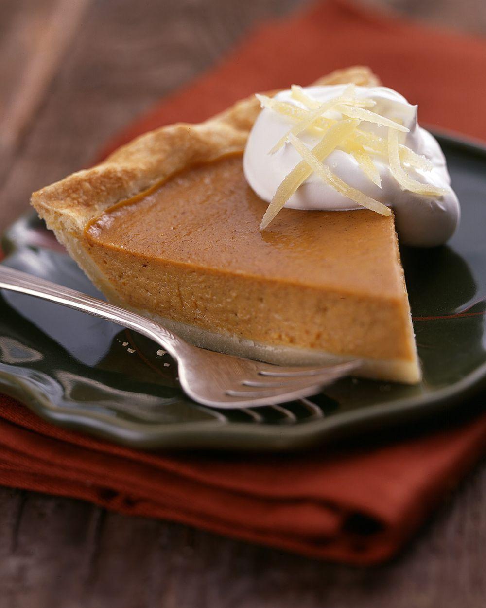 Pumpkin pie slice with whipped cream