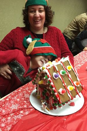 Zermatt_Swiss_Christmas_2017_Midway_Utah_Shy_Child_With_Gingerbread_House_GH_Image.jpg