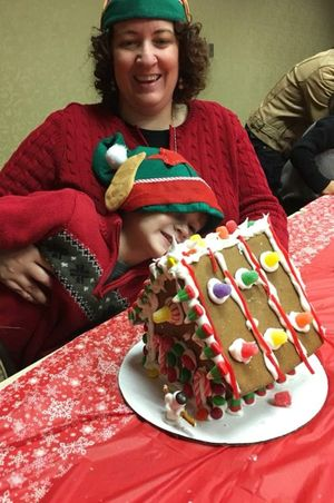 Zermatt_Swiss_Christmas_2017_Midway_Utah_Shy_Child_With_Gingerbread_House.jpg