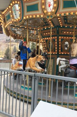 Zermatt_Swiss_Christmas_2017_Midway_Utah_Child_On_Carousel_Tiger.jpg
