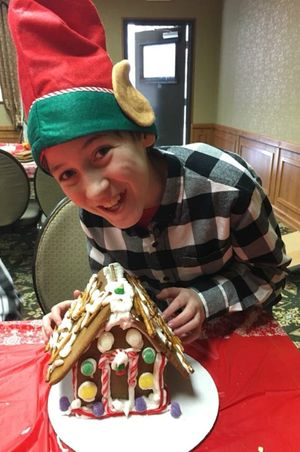 Zermatt_Swiss_Christmas_2017_Midway_Utah_Smiling_Elf_With_Gingerbread_House.jpg