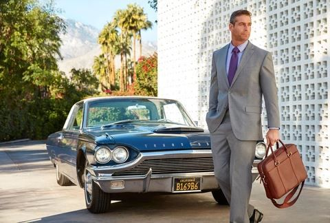 Brittany guy and briefcase with Car.JPG
