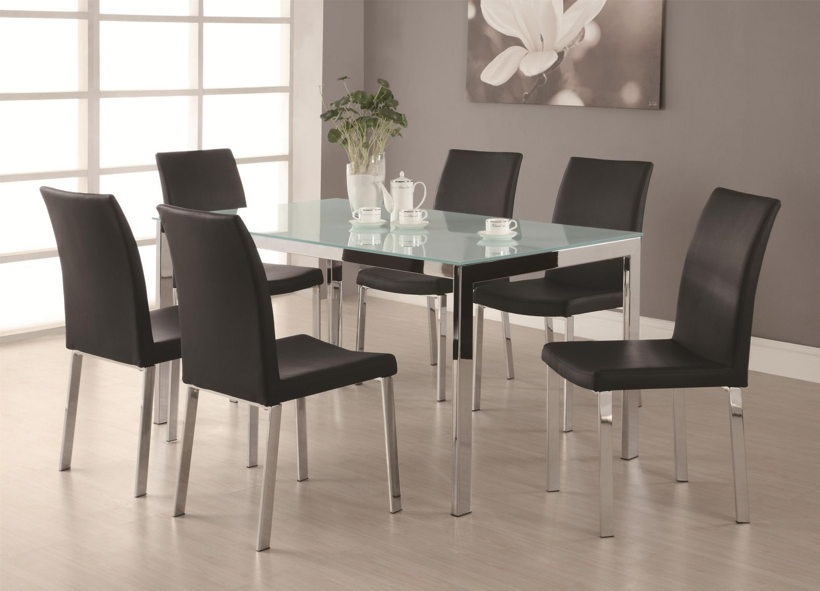 Coaster Dining Room Set  Price Upon Request Call (631) 742-1351 for Best Price Guarantee The Bryn dining room furniture set has a modern sensibility that lets you enjoy your meals in a remarkably sleek space. The lustrous chrome table base comes with a fro