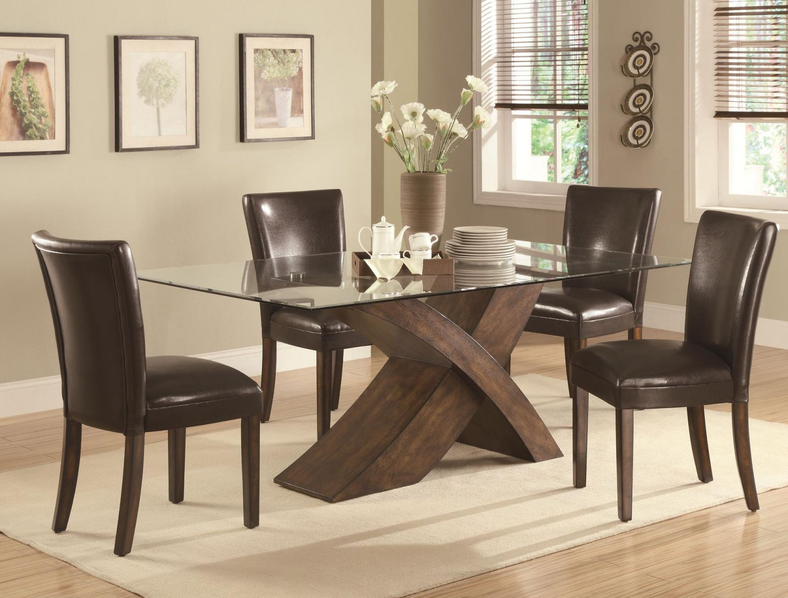 Coaster Dining Room Set Price Upon Request Call (631) 742-1351 for Best Price Guarantee The Nessa dining collection features a large scaled X base dining table and chair set that will make a bold statement in your dining room. Crafted from ash veneers and