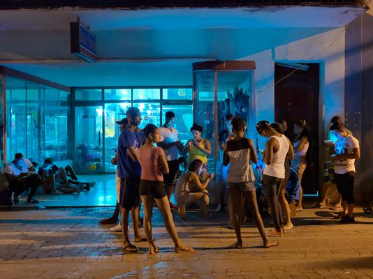 Young Cubans on Their Social Media Devices at an Internet Hot Spot, Old Havana, Cuba 2016