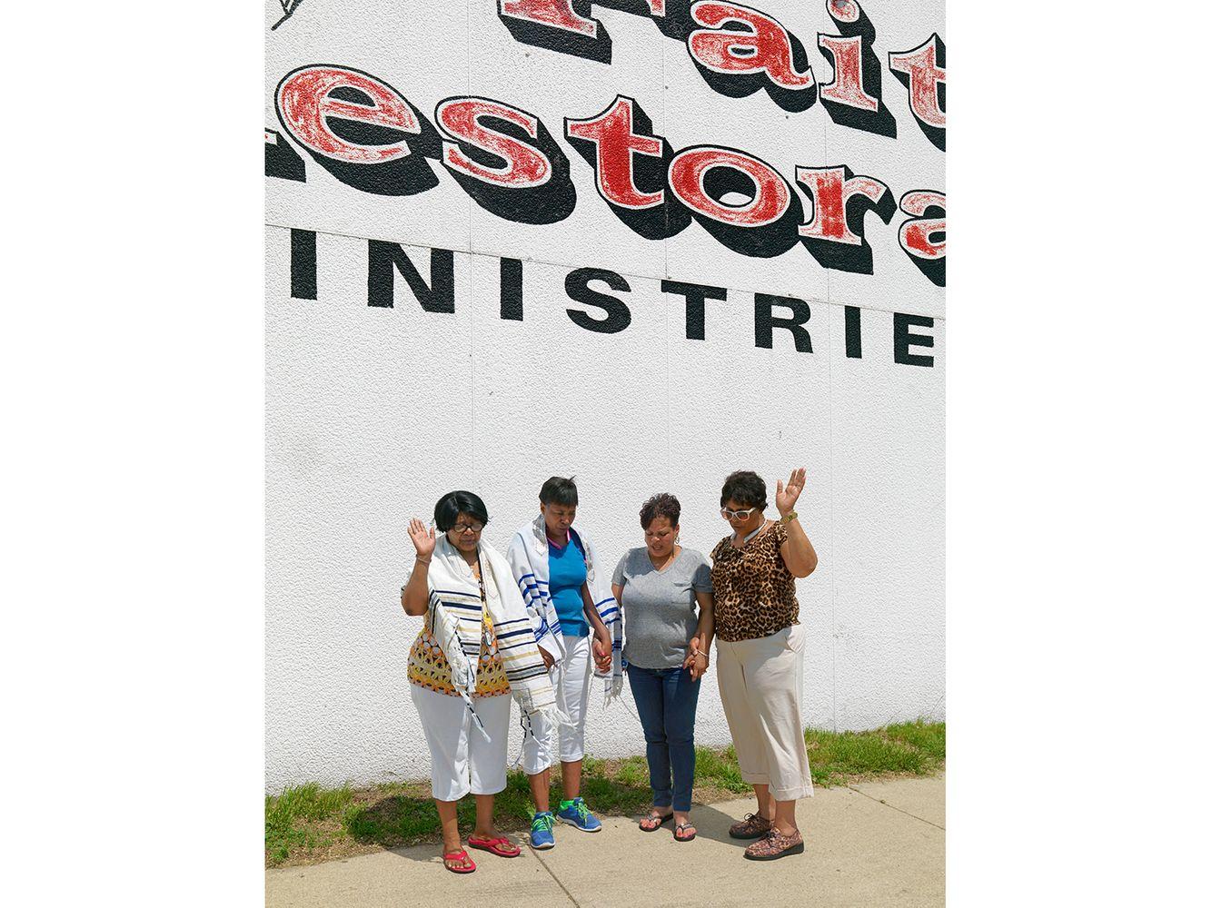 Four church women praying on Harper Avenue. Eastside, Detroit 2015