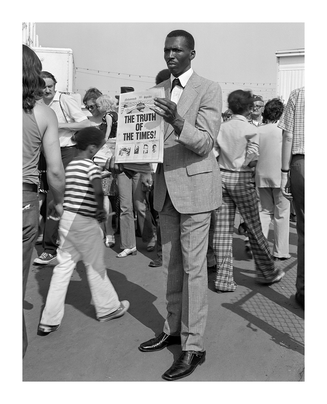 Black Man Handing out Muslim Newspaper, Detroit, 1 July 1973