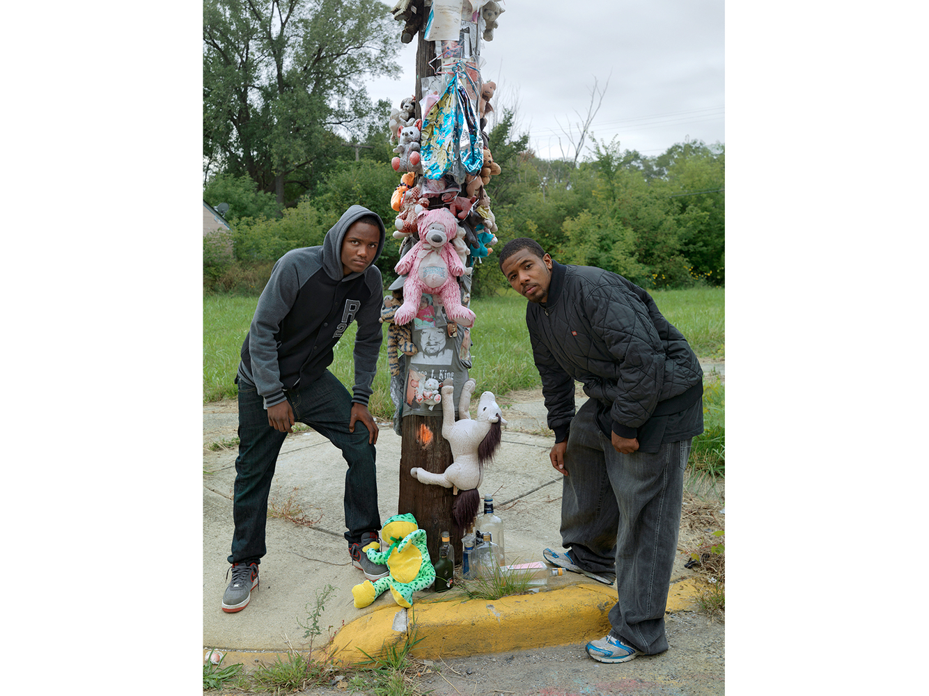 Two Men Pose in Front of a Memorial for their Deceased Friend, Eastside, Detroit 2014