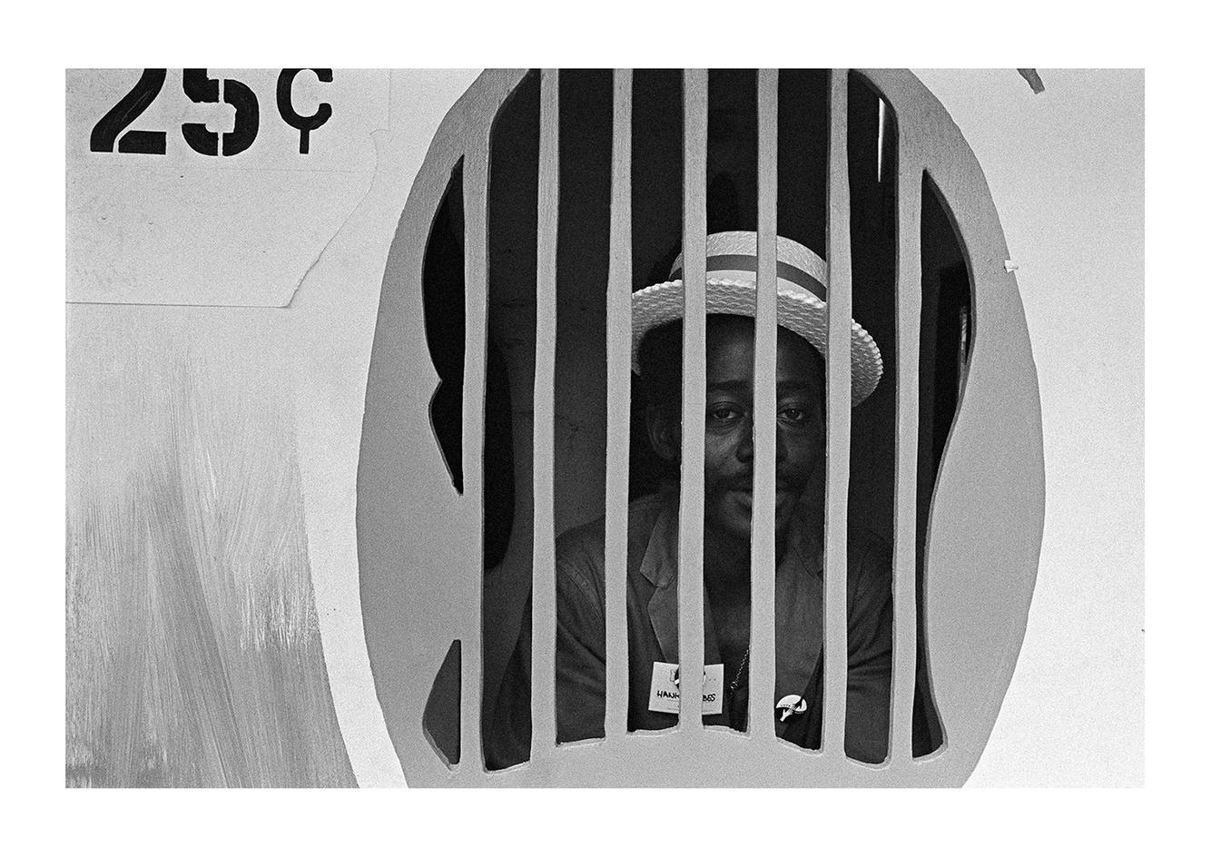 Man Inside a Ticket Booth, Detroit 1972