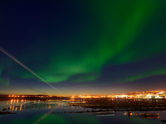 Aurora Borealis with a Trail of Airplane Landing Lights, Iqaluit, Canada 2016