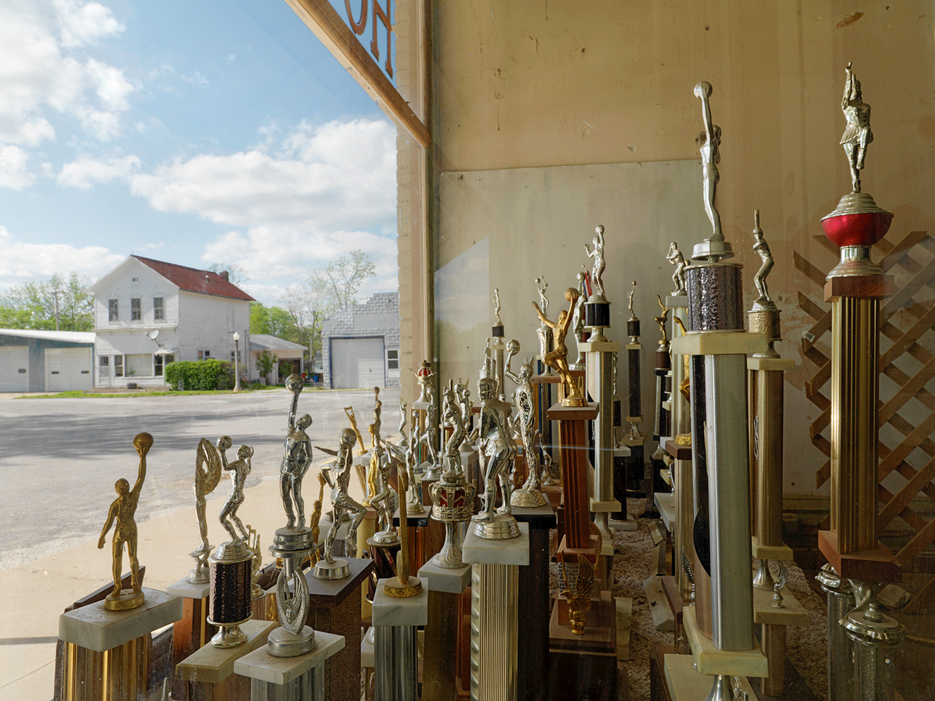 Trophies in an Abandoned Storefront Window, Plymouth, IL 2009