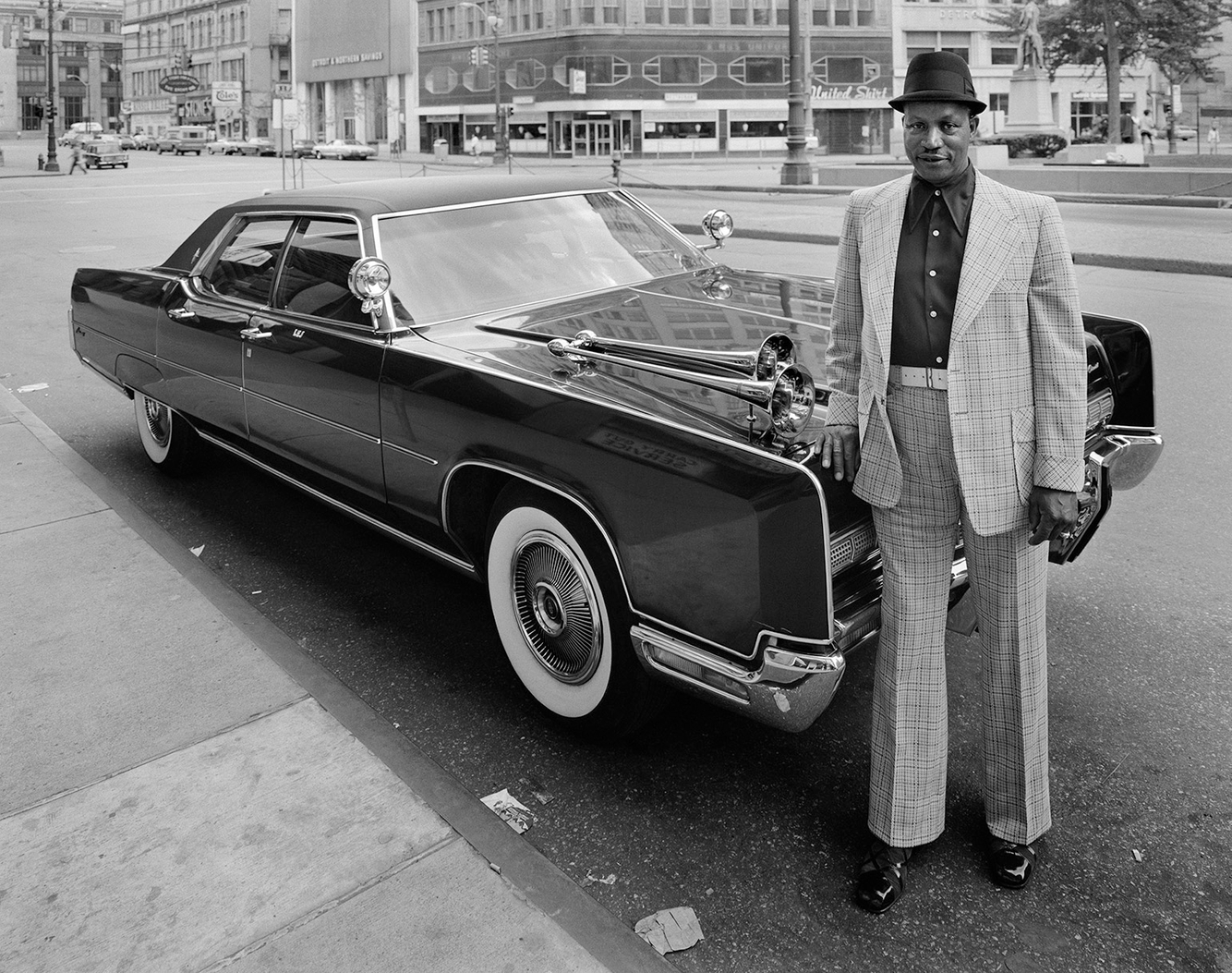 Lawrence Jackson w/his Lincoln on Griswold St., Detroit, 26 May 74