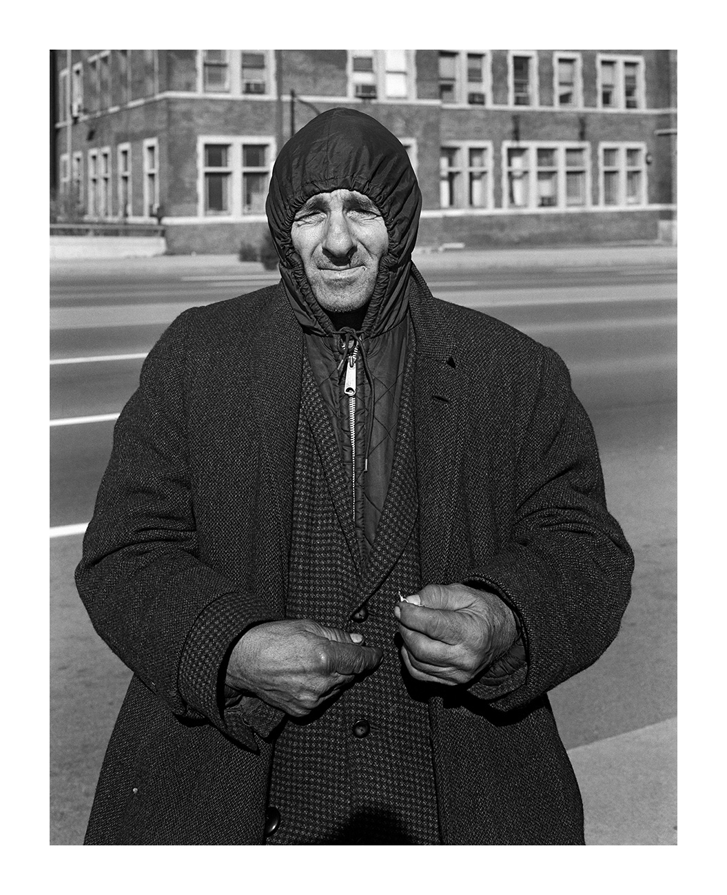 A Man Wearing Several Coats Holding a Piece of Paper, Detroit, MI 3 Nov 73