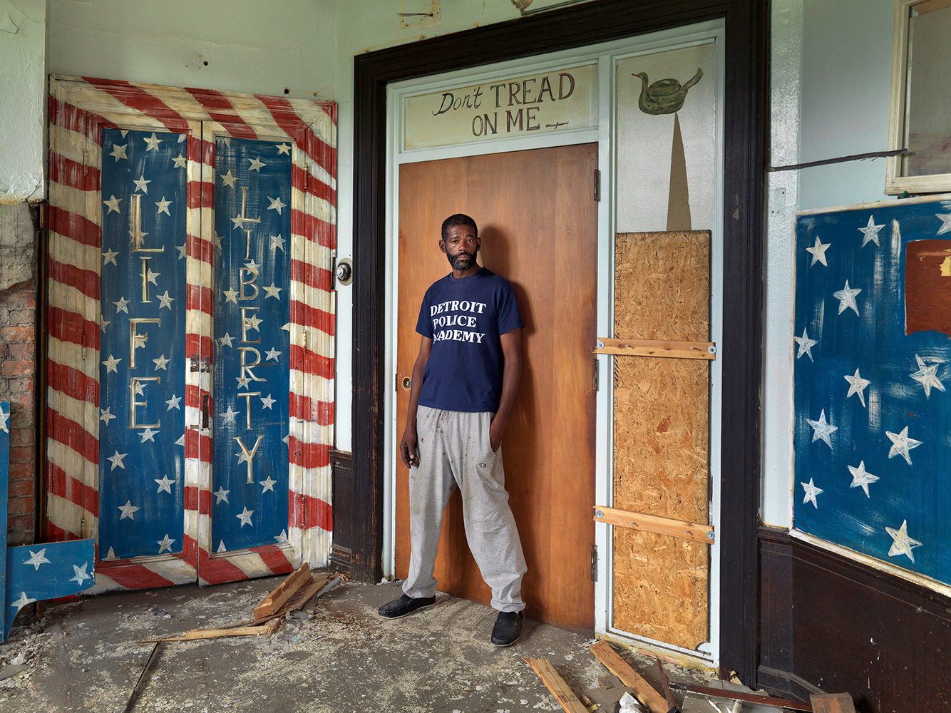 Cornell Standing in the Front Room of an Abandoned House He was Squating In, Eastside, Detroit 2013