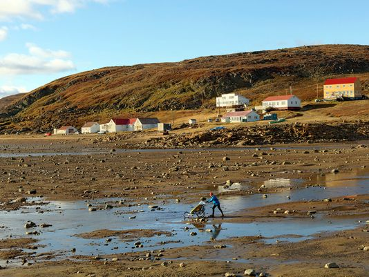 A Woman Taking a Shortcut During Low Tide, Iqaluit, Canada 2016