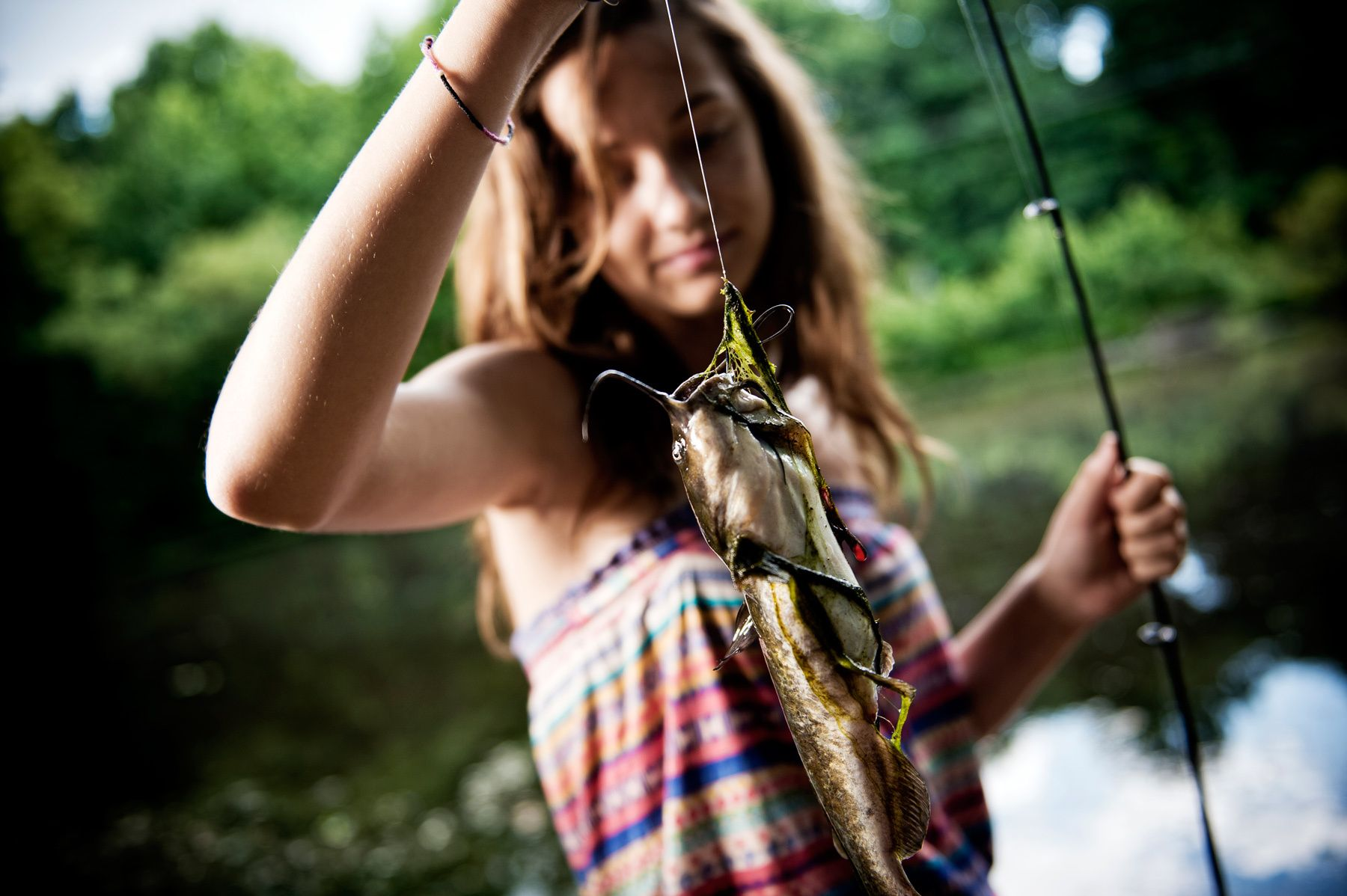1hunting_and_gathering_young_woman_catches_catfish_dsc1609