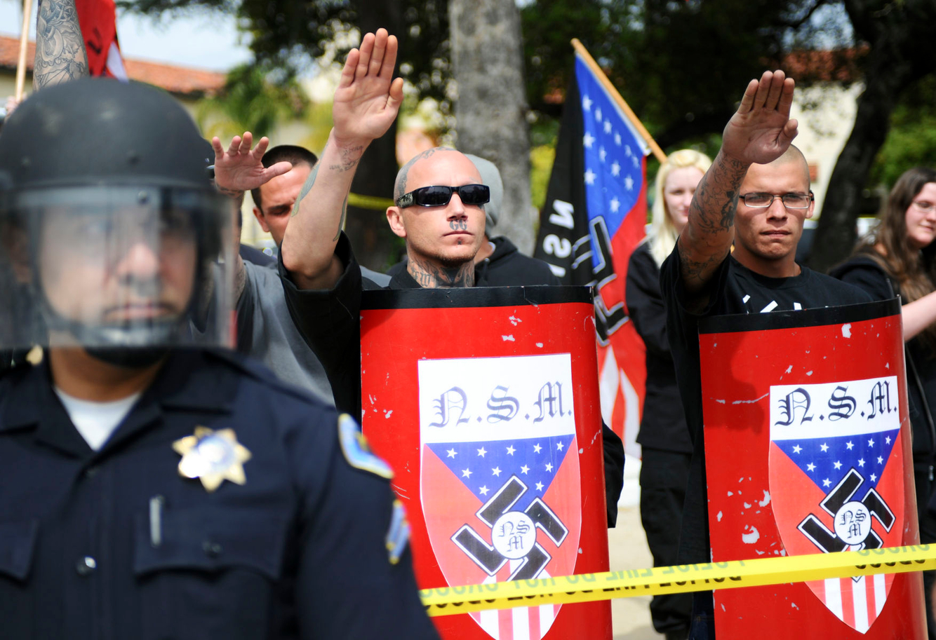 NAZI RALLY: Pro-Nazi supporters salute at a National Socialist Movement rally in Claremont, California