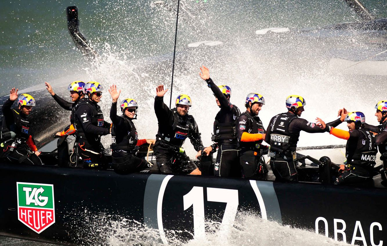 Oracle Team USA waves to spectators after winning race 16
