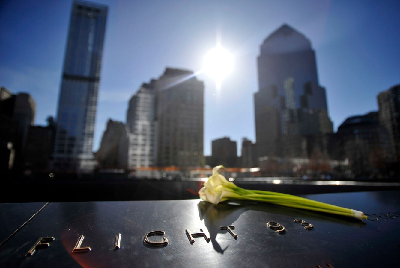 A flower is placed at the World Trade Center memorial in New York City.