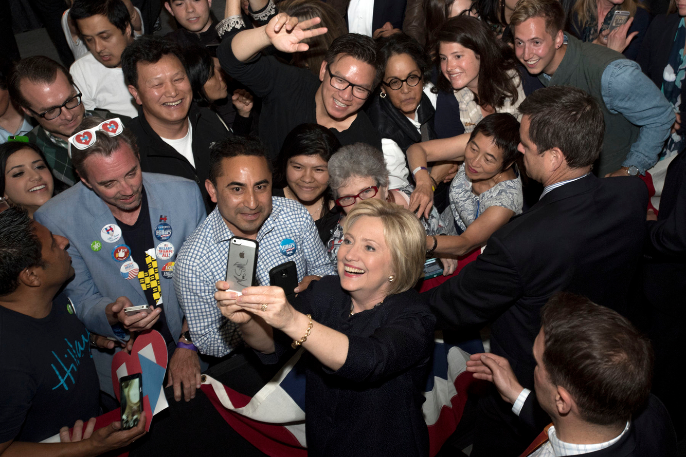 Hillary Clinton takes a selfie during a campaign event.