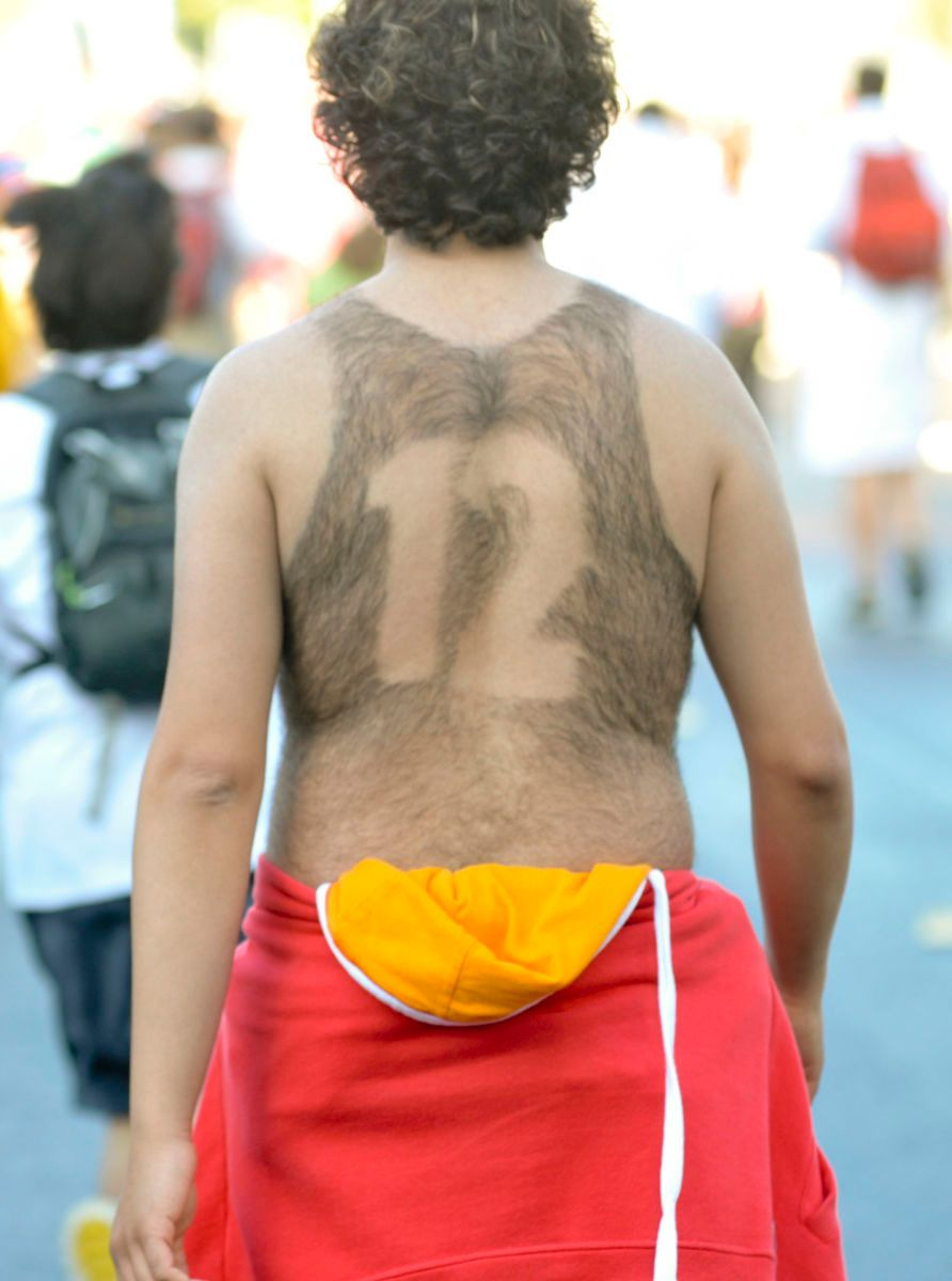 MARATHON: A number is shaved into a man's back during Bay to Breakers