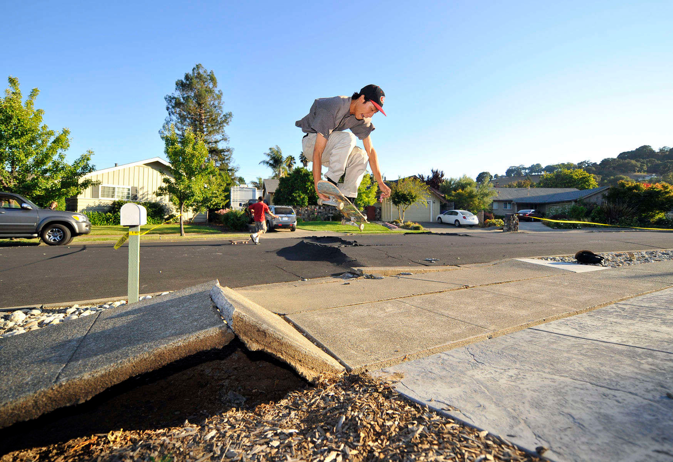 EARTHQUAKE: A skateboarder launches over a buckled sidewalk after a 6.1 Earthquake struck in Napa, California.