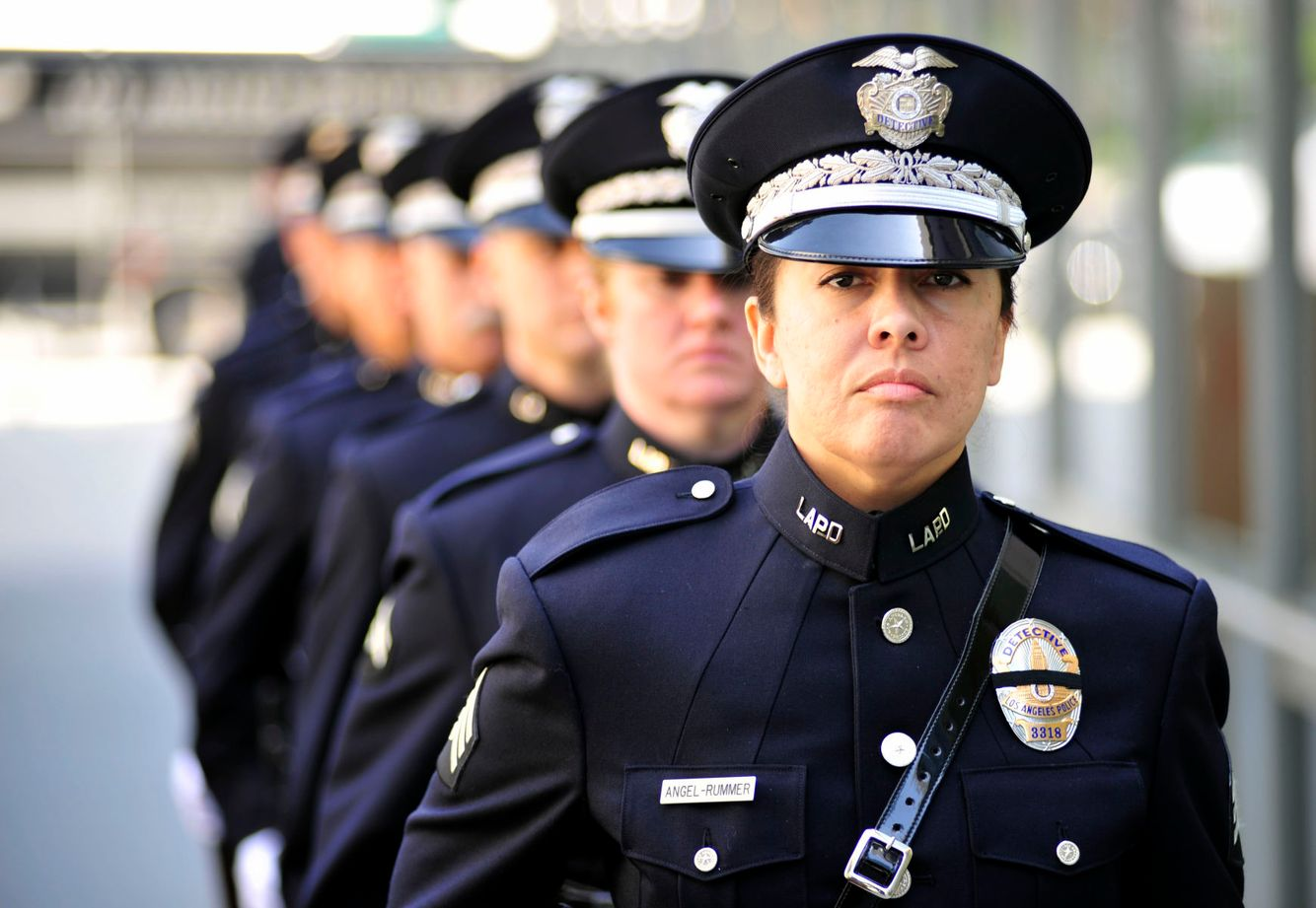 MEMORIAL: Detective Angel Rummer honors fallen LAPD officers during a 21-rifle Volley in Los Angeles