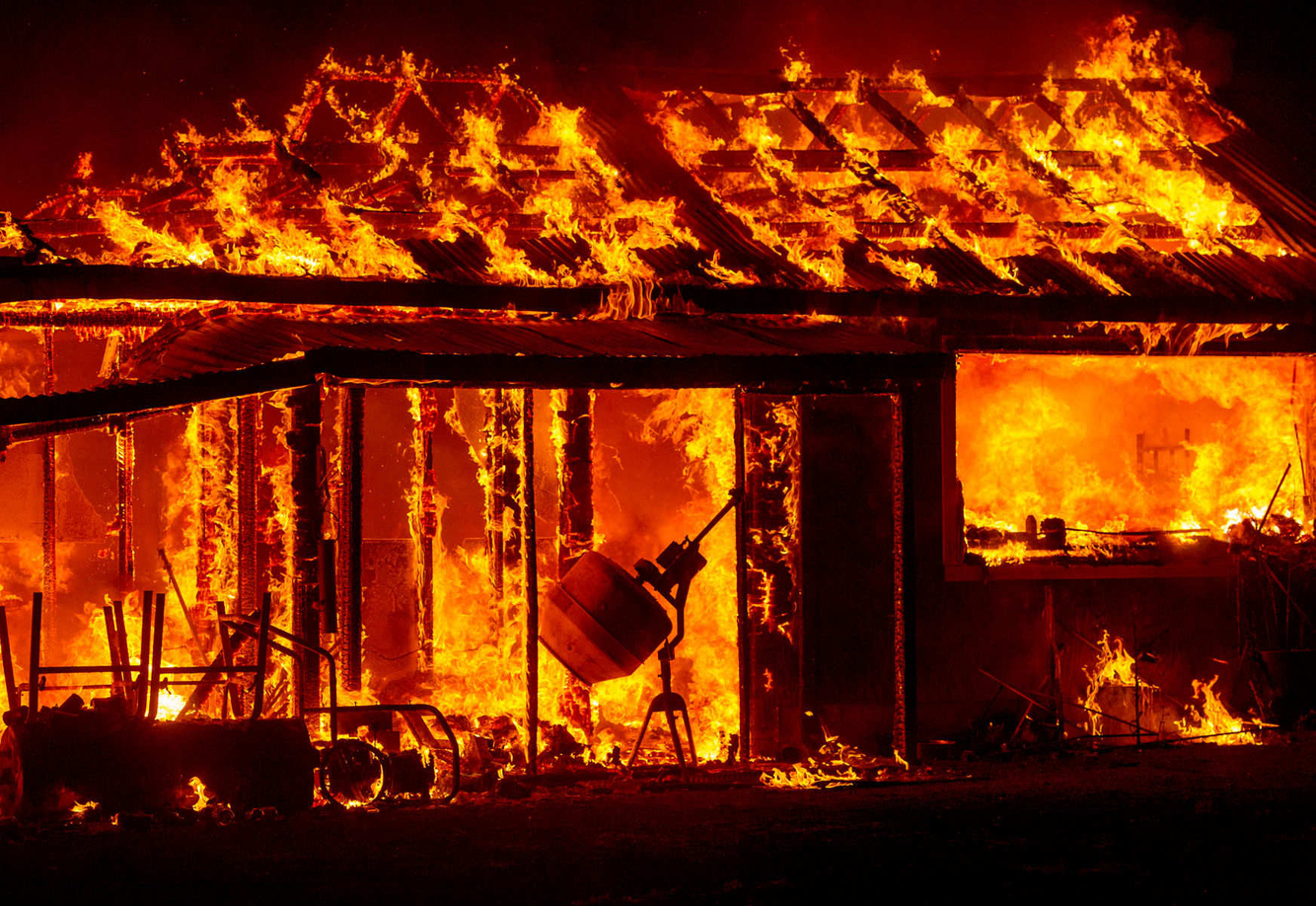 A house is engulfed in flames during the Valley fire in Siegler Springs, California