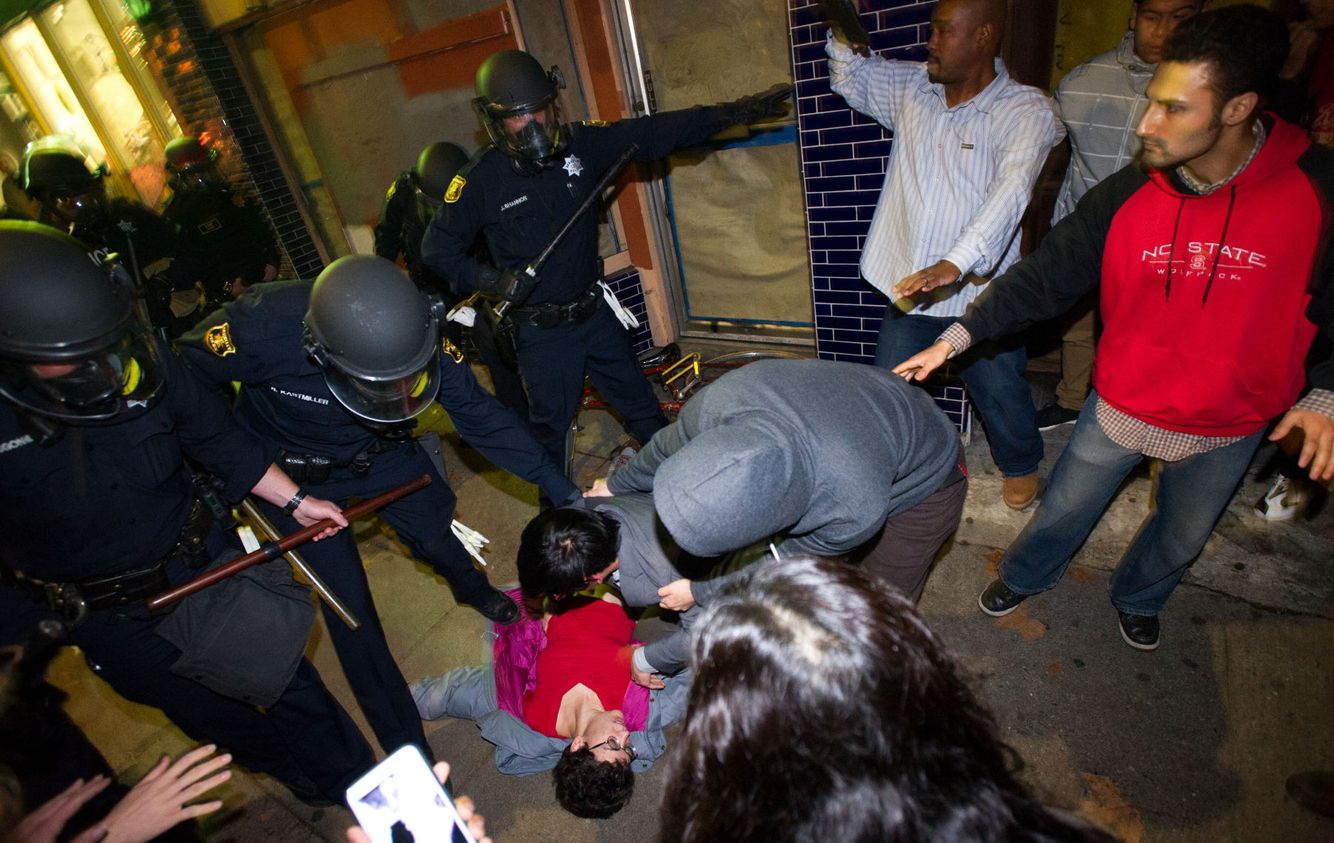 PROTESTS: Police and protesters react as a woman has a seizure during anti-police brutality demonstrations in Berkeley, California.